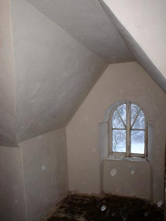 Attic room: finished lime plaster on lath.