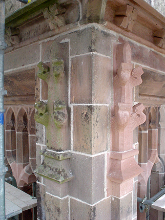 Comparison between existing and replacement carved masonry finials and string courses.