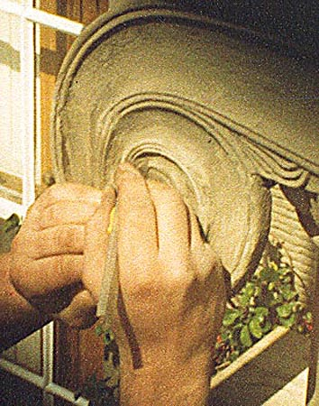 During works: carving of volute moulding.