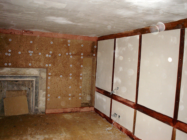 Internal lime plastering works: works included consolidation and repair of original masonry fireplace.