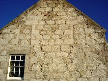 Gable wall: note condition of masonry and extent of repointing works.