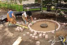 Mary Slessor Memorial: setting out concrete foundation and granite set.
