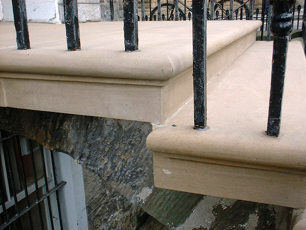 After works: detail of masonry arch and railings.
