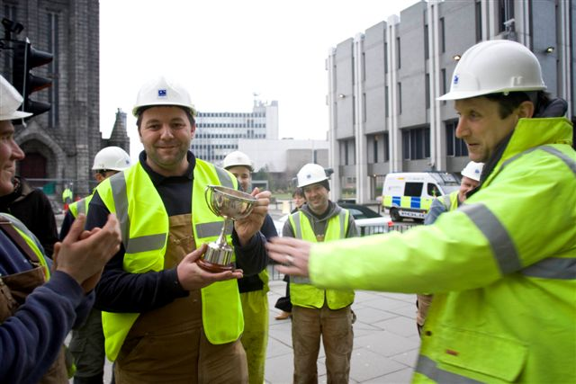 Steven Harper receives his Employee of the Year trophy at the Marischal topping out ceremony