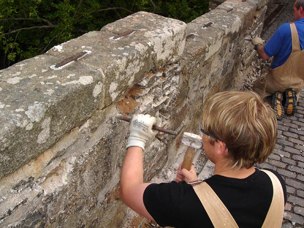 Repair works: extent of mortar and masonry removal.