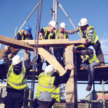Photograph showing erection of the Timber Frame for the Pavillion.