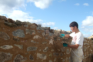 Photograph of a Maltese Student doing Traditional Lime Pointing